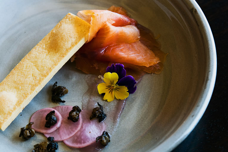 House cured tasmanian salmon with lemon wafers, fried capers, red onion gels and pickled radish